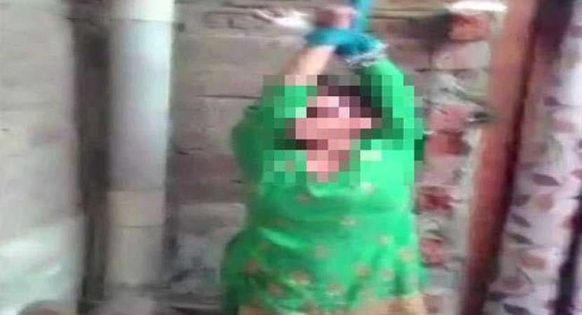 Still image from the video of man beating wife for dowry