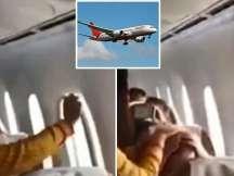 Air India flight passengers injured after turbulance, window panel damaged