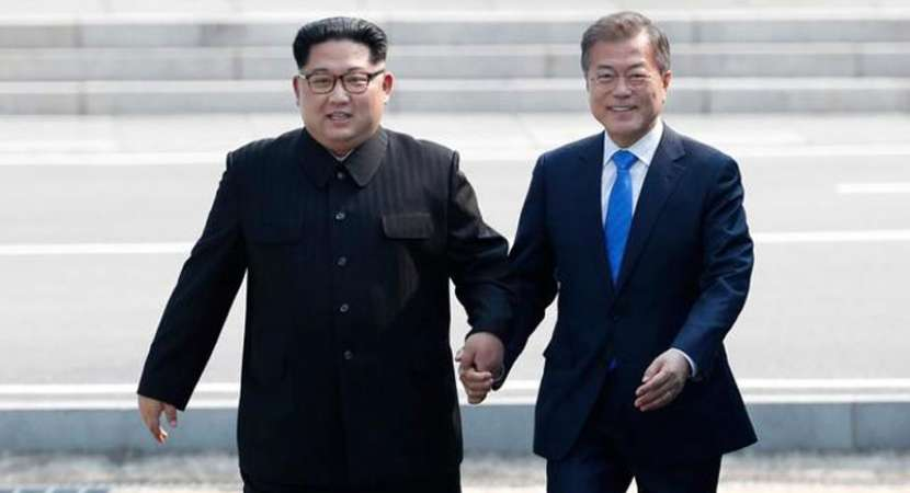 Historic summit begins as Kim Jong Un crosses border to meet Moon