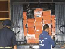 "Photos show police carrying out orange boxes, with labels reading ""Paris, H Bag Gray Croco Skin Hermes."""