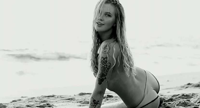 Model Ireland Baldwin flaunting red rose tattoo