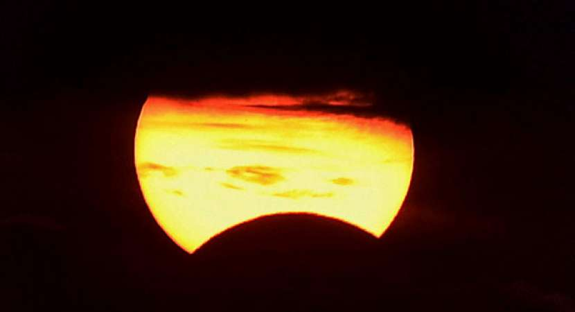 Partial solar eclipse takes place when the sun, moon, and Earth are almost lined up with each other